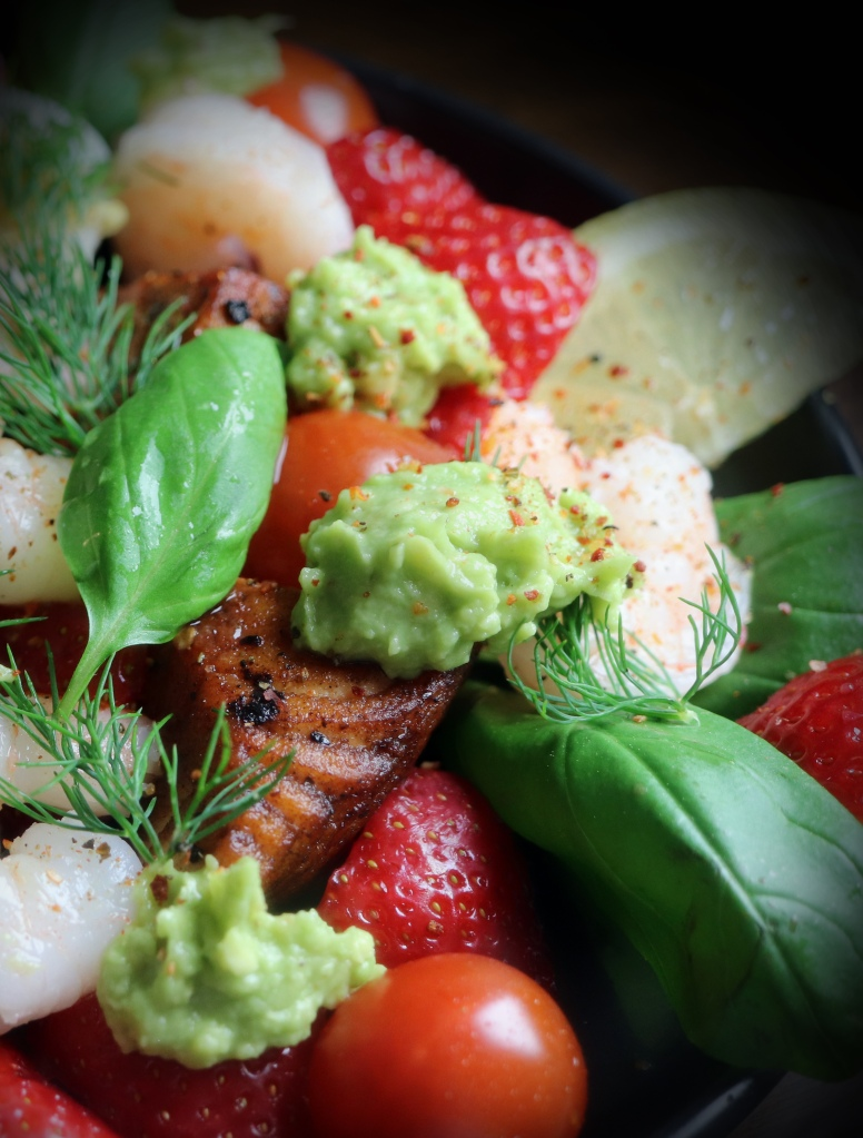 Delicious salmon salad with berreis, avocado and prawns. And lovely spice and herbs!